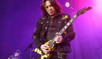 """""""The minute some people hear the word 'Christian' they run away from it as fast as they can,"""" Michael Sweet of the rock band Stryper said. (Associated Press)"""