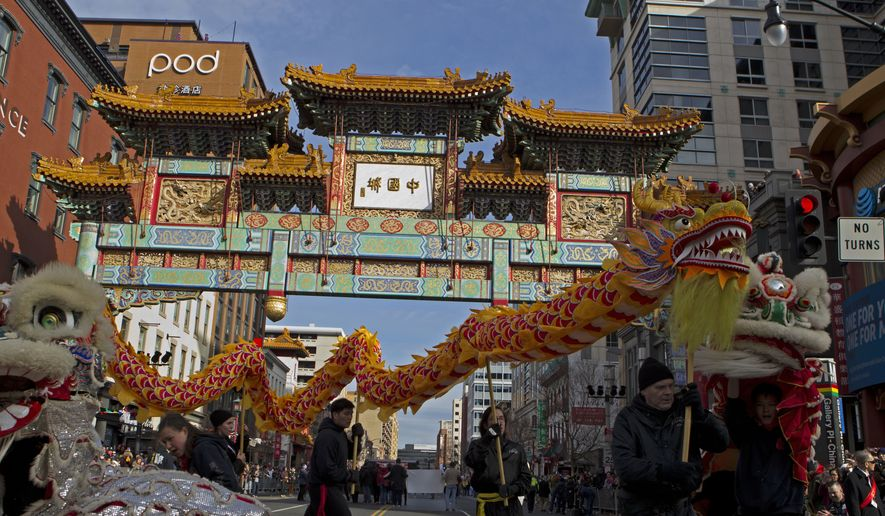 Dancers perform the lion and dragon dances, during Chinese New Year celebrations in Chinatown, in Washington, Sunday, Feb. 10, 2019.. (AP Photo/Jose Luis Magana) **FILE**