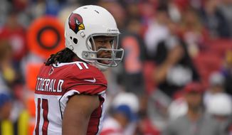Arizona Cardinals wide receiver Larry Fitzgerald stands on the field during the first half of an NFL football game against the Los Angeles Rams Sunday, Dec. 29, 2019, in Los Angeles. (AP Photo/Mark J. Terrill)