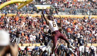 Minnesota wide receiver Tyler Johnson reaches for a pass that he caught for a touchdown late in the second quarter against Auburn in the Outback Bowl NCAA college football game Wednesday, Jan. 1, 2020, in Tampa, Fla. (Aaron Lavinsky/Star Tribune via AP)