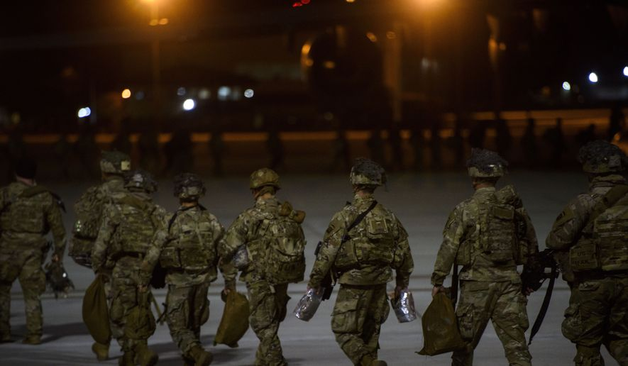 Soldiers board a C-17 aircraft Wednesday, Jan. 1, 2020 at Fort Bragg, N.C., to be deployed in Iraq. (Melissa Sue Gerrits/The Fayetteville Observer via AP) ** FILE **