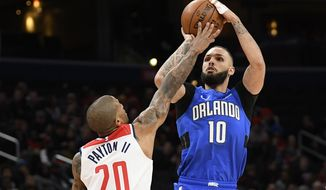 Orlando Magic guard Evan Fournier (10) shoots as Washington Wizards guard Gary Payton II (20) defends during the first half of an NBA basketball game Wednesday, Jan. 1, 2020, in Washington. (AP Photo/Nick Wass)