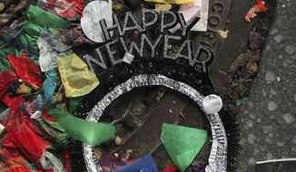 Confetti and other debris lies on the street in New York's Times Square, early New Year's Day, Wednesday, Jan. 1, 2020. (AP Photo/Tina Fineberg)