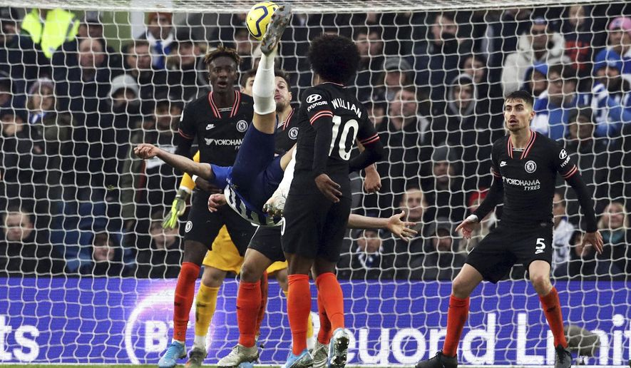 Brighton's Alireza Jahanbakhsh, centre, scores his side's first goal of the game, during the English Premier League soccer match between Brighton and Chelsea at the AMEX Stadium, Brighton, England, Wednesday Jan. 1, 2020. (Gareth Fuller/PA via AP)