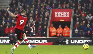 Southampton's Danny Ings scores his side's first goal of the game, during the English Premier League soccer match between Southampton and Tottenham Hotspur at St Mary's Stadium, in Southampton, England, Wednesday Jan. 1, 2020. (Mark Kerton/PA via AP)