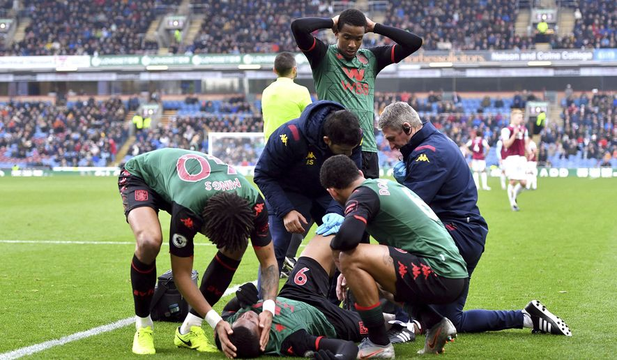 Aston Villa's Wesley receives treatment after an injury , during the English Premier League soccer match between Burnley and Aston Villa, at Turf Moor, Burnley, England, Wednesday Jan. 1, 2020. (Anthony Devlin/PA via AP)