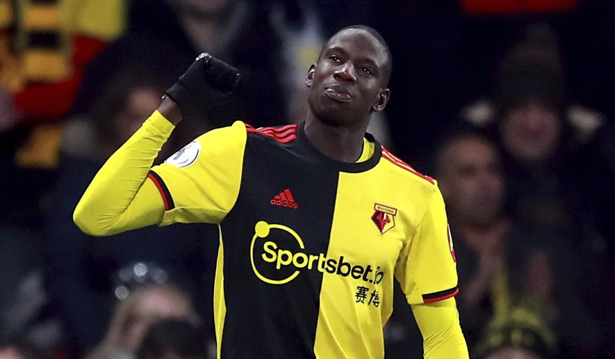 Watford's Abdoulaye Doucoure celebrates scoring his side's second goal of the game, during the English Premier League soccer match between Watford and Wolverhampton Wanderers at Vicarage Road, in Watford, England, Wednesday, Jan. 1, 2020. (Adam Davy/PA via AP)