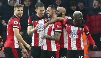 Southampton's Danny Ings, centre, celebrates with teammates after scoring his side's first goal during the English Premier League soccer match between Southampton and Tottenham Hotspur at St Mary's Stadium, in Southampton, England, Wednesday Jan. 1, 2020. (Mark Kerton/PA via AP)
