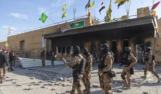 Iraqi army soldiers are deployed in front of the U.S. Embassy, in Baghdad, Iraq, Wednesday, Jan. 1, 2020. Iran-backed militiamen have withdrawn from the U.S. Embassy compound in Baghdad after two days of clashes with American security forces. (AP Photo/Nasser Nasser) ** FILE **