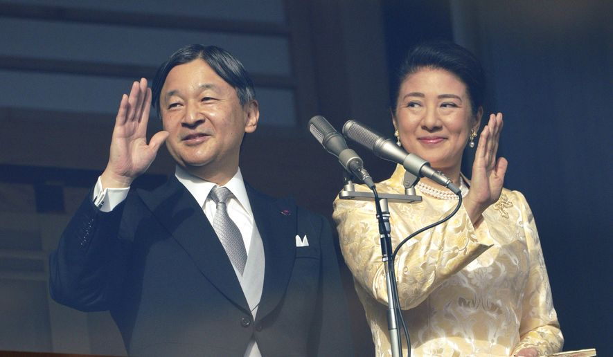 Japan's Emperor Naruhito waves with Empress Masako to well-wishers from the bullet-proofed balcony during a public appearance with his imperial families at Imperial Palace in Tokyo Thursday, Jan. 2, 2020, in Tokyo. (AP Photo/Eugene Hoshiko)