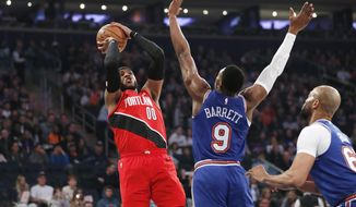 New York Knicks guard RJ Barrett (9) defends as Portland Trail Blazers forward Carmelo Anthony (00) shoots during the first half of an NBA basketball game in New York, Wednesday, Jan. 1, 2020. (AP Photo/Kathy Willens)