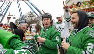 Dallas Stars fans get hyped in the midway outside the Cotton Bowl before the NHL Winter Classic hockey game between the Dallas Stars and the Nashville Predators, Wednesday, Jan. 1, 2020, in Dallas. (AP Photo/Jeffrey McWhorter)