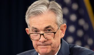 FILE - In this July 31, 2019, file photo, Federal Reserve Chairman Jerome Powell speaks during a news conference following a two-day Federal Open Market Committee meeting in Washington. President Donald Trump is calling on the Federal Reserve to cut interest rates by at least a full percentage-point over a fairly short period of time, saying such a move would make the U.S. economy even better and would also greatly and quickly enhance the global economy. In two tweets Monday, Aug. 19, Trump kept up his pressure on the Fed and Powell, saying the U.S. economy was strong despite the horrendous lack of vision by Jay Powell and the Fed. (AP Photo/Manuel Balce Ceneta, File)