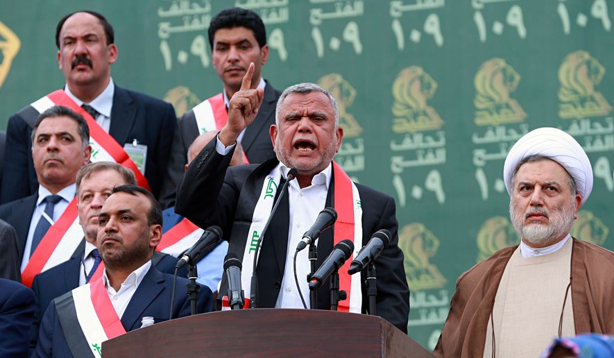 Hadi al-Amiri (center), commander of the Popular Mobilization Forces, speaks to his followers during his political block campaign rally in Baghdad, Iraq, Monday, May 7, 2018. Iraqis head to the polls next weekend for the first time since the government declared victory against the Islamic State group, in national elections that could tilt the balance of power between the United States and Iran. (AP Photo/Hadi Mizban) **FILE**