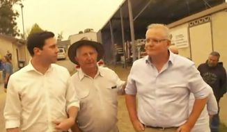In this still image taken from video provided by AuBC, Australian Prime Minister Scott Morrison (far right) is confronted by angry residents as he visited a wildfire-ravaged Cobargo, in New South Wales on Thursday, Jan. 2, 2020. The outpouring of anger came as authorities said 381 homes had been destroyed on the New South Wales southern coast this week. More than 200 fires are burning in Australia's two most-populous states. (AuBC via AP)