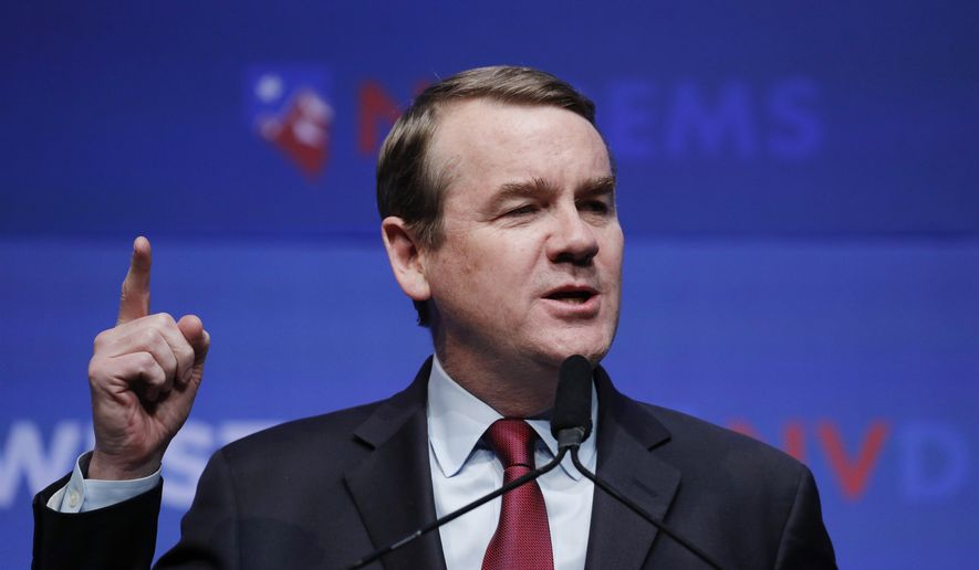 In this Sunday, Nov. 17, 2019, file photo, Democratic presidential candidate U.S. Sen. Michael Bennet, D-Colo., speaks during a fundraiser for the Nevada Democratic Party, in Las Vegas. (AP Photo/John Locher, File)