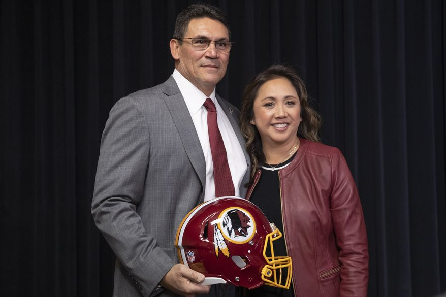 Washington Redskins new head coach Ron Rivera, left, and his wife Stephanie Rivera, pose for a picture during a news conference at the team's NFL football training facility, Thursday, Jan. 2, 2020 in Ashburn, Va. (AP Photo/Alex Brandon) ** FILE **