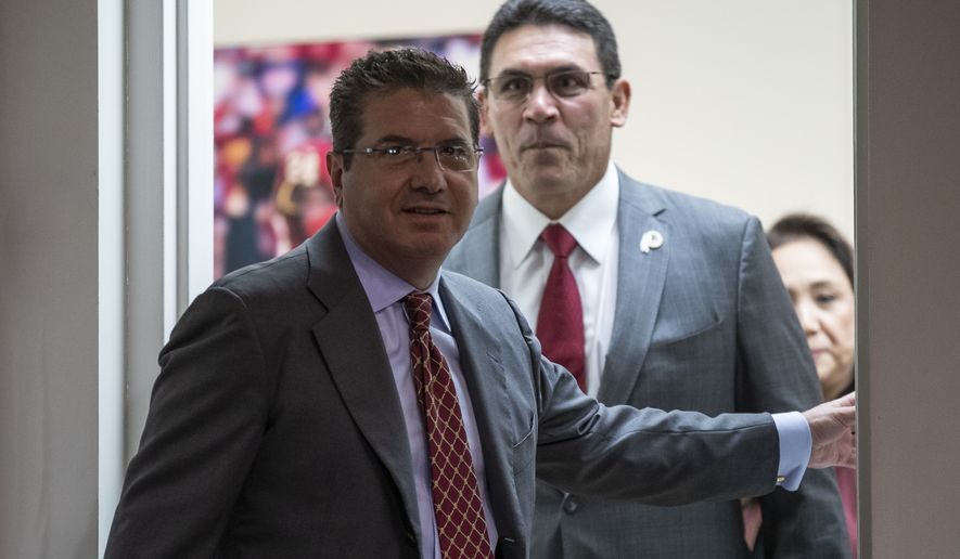 Washington Redskins owner Dan Snyder, left, arrives with new head coach Ron Rivera for a news conference at the team's NFL football training facility, Thursday, Jan. 2, 2020, in Ashburn, Va. (AP Photo/Alex Brandon)