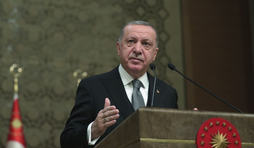 Turkey's President Recep Tayyip Erdogan deliver a speech at an event in Ankara, Turkey,Thursday, Jan. 2, 2020. Turkey's parliament on Thursday authorised the deployment of troops to Libya to support the U.N.-backed government in Tripoli battle forces loyal to a rival government that is seeking to capture the capital. Turkish lawmakers voted 325-184 at an emergency session in favour of a one-year mandate allowing the government to dispatch troops amid concerns that Turkish forces could aggravate the conflict in Libya and destabilise the region. (Presidential Press Service via AP, Pool)