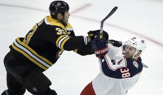 Boston Bruins defenseman Zdeno Chara (33) pushes off Columbus Blue Jackets center Boone Jenner (38) in the first period of an NHL hockey game, Thursday, Jan. 2, 2020, in Boston. (AP Photo/Elise Amendola)