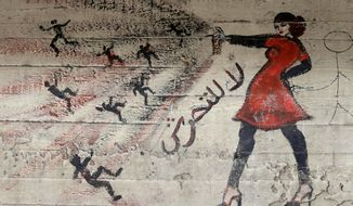 """FILE - In this May 24, 2013 file photo, a mural with Arabic that reads """"no harassment,"""" is seen on a wall in Cairo, Egypt.  A video from Egypt showing a woman enduring a mob sexual assault on New Year's Eve was deemed authentic by the country's police Thursday, Jan. 2, 2020. The viral video has reignited long-running controversy over rampant sexual harassment in Egypt. Cases of mob violence against women have been caught on tape since the 2000s.(AP Photo/Hassan Ammar, File)"""