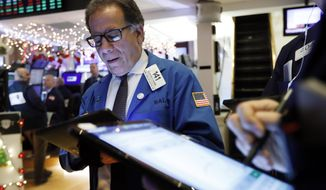In this Dec. 11, 2019, file photo trader Sal Suarino works on the floor of the New York Stock Exchange. The U.S. stock market opens at 9:30 a.m. EST on Thursday, Jan. 2, 2020. (AP Photo/Richard Drew, File)