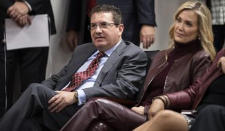 Washington Redskins owner Dan Snyder, left, and his wife Tanya Snyder, listen to head coach Ron Rivera during a news conference at the team's NFL football training facility, Thursday, Jan. 2, 2020 in Ashburn, Va. (AP Photo/Alex Brandon)