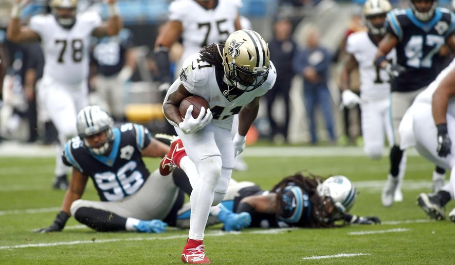 New Orleans Saints running back Alvin Kamara (41) runs for a touchdown against the Carolina Panthers during the first half of an NFL football game in Charlotte, N.C., Sunday, Dec. 29, 2019. (AP Photo/Brian Blanco)