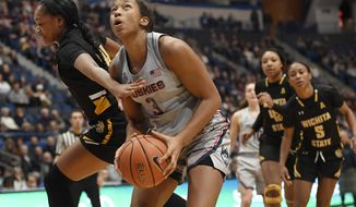 Connecticut's Megan Walker looks to shoot as Wichita State's Shyia Smith, left, defends during the second half of an NCAA college basketball game Thursday, Jan. 2, 2020, in Hartford, Conn. (AP Photo/Jessica Hill)