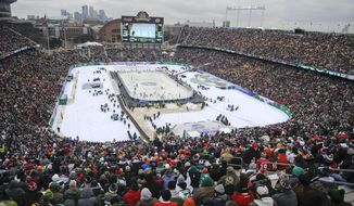 FILE - In this Feb. 21, 2016, file photo, more than 50,000 fans watch the Minnesota Wild play the Chicago Blackhawks at TCF Bank Stadium during the NHL Stadium Series hockey game, in Minneapolis. The Minnesota Wild, after years of lobbying the league, will finally host the NHL's signature regular season event next year. The 2021 Winter Classic will coincide with the franchise's 20th anniversary season. (AP Photo/Craig Lassig, File)