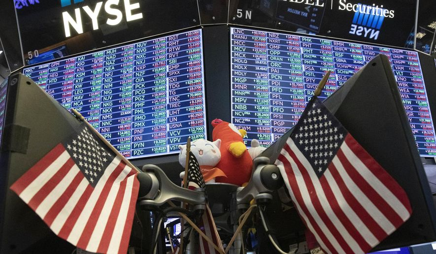 FILE - In this Sept. 18, 2019, file photo, stock prices are displayed at the New York Stock Exchange. Funds of all types made money through 2019, from risky ones full of stocks from developing economies to stodgy funds holding only super-safe Treasury bonds. (AP Photo/Mark Lennihan, File)