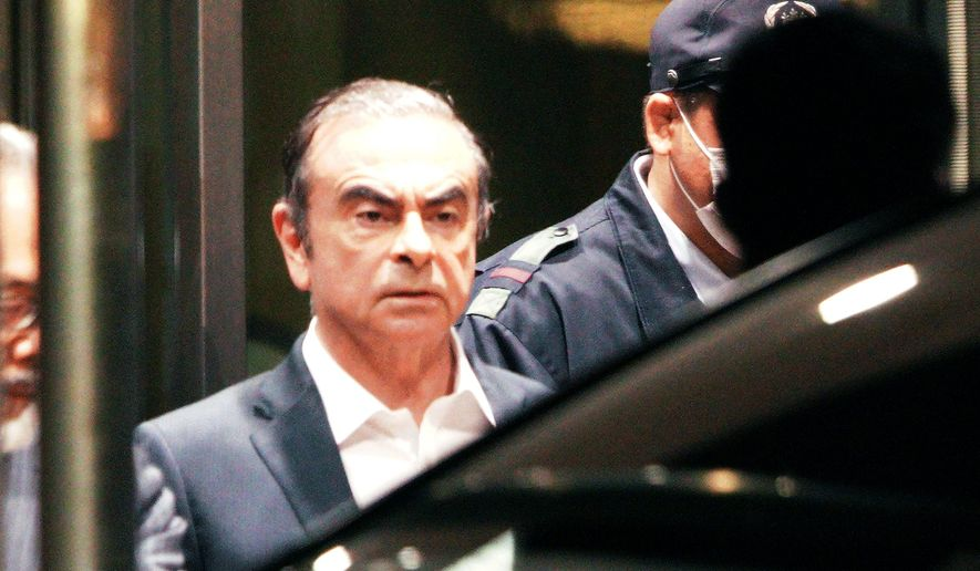 In this April 25, 2019, former Nissan Chairman Carlos Ghosn leaves the Tokyo Detention Center in Tokyo. A Japanese court has turned down an appeal from the lawyers of Ghosn over his bail conditions that limit his contact with his wife. Kyodo News service reported Thursday the Tokyo District Court rejected the appeal filed earlier in the day. (AP Photo/Eugene Hoshiko, File)