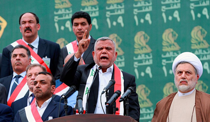"""Iranian """"proxy"""" Hadi al-Amiri, a leader of the siege this week on the U.S. Embassy in Iraq, met at the White House with President Obama and was photographed with Joseph R. Biden. (Associated Press)"""