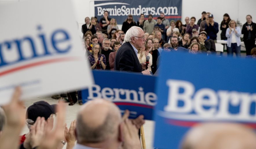 Democratic presidential candidate Sen. Bernie Sanders, I-Vt., pauses as members of the audience applaud him at a rally at the Winneshiek County Fairgrounds, Friday, Jan. 3, 2020, in Decorah, Iowa. (AP Photo/Andrew Harnik)