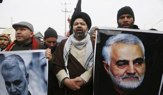 Kashmiri Shiite Muslims shout anti American and Israeli slogans during a protest against U.S. airstrike in Iraq that killed Iranian Revolutionary Guard Gen. Qassem Soleimani at Magam 37 kilometers (23 miles) North of Srinagar, Indian controlled Kashmir, Friday, Jan. 3, 2020. The killing of Iran's top military commander Gen. Qassem Soleimani triggered several anti-U.S. protests in Indian-controlled Kashmir, the protesters also shut down shops and businesses in Magam and Budgam towns in south Kashmir. (AP Photo/Mukhtar Khan)