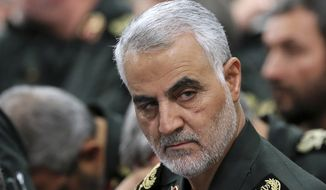 In this Sept. 18, 2016, photo released by an official website of the office of the Iranian supreme leader, Revolutionary Guard Gen. Qassem Soleimani, center, attends a meeting with Supreme Leader Ayatollah Ali Khamenei and Revolutionary Guard commanders in Tehran, Iran. A U.S. airstrike near Baghdad's airport on Friday Jan. 3, 2020 killed Gen. Qassem Soleimani, the head of Iran's elite Quds Force. Soleimani was considered the architect of Iran's policy in Syria. (Office of the Iranian Supreme Leader via AP) **FILE**