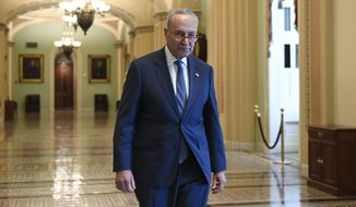 Senate Minority Leader Sen. Chuck Schumer of N.Y., walks on Capitol Hill in Washington, Friday, Jan. 3, 2020. (AP Photo/Susan Walsh)