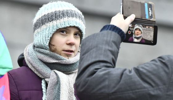 """Swedish environmental activist Greta Thunberg celebrates her 17th birthday by attending the weekly """"Fridays For Future"""" climate strike outside the Swedish parliament in Stockholm, Sweden, Friday Jan. 3, 2020. (Claudio Bresciani/TT via AP)"""