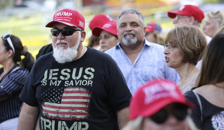 Jorge Alfonso, 56, of Miami, waits in line outside of the King Jesus International Ministry church where President Donald Trump is slated to hold a rally for evangelical supporters, Friday, Jan. 3, 2020, in Miami. Alfonso, originally from Cuba, has been a parishioner at the church for five years. (AP Photo/Lynne Sladky)