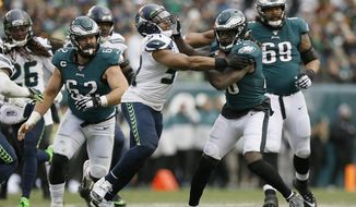 FILE - In this Nov. 24, 2019, file photo, Philadelphia Eagles' Jay Ajayi (28) tries to break free from Seattle Seahawks' Bobby Wagner during the second half of an NFL football game in Philadelphia. Wagner was named to The Associated Press' All-Pro Team for the fifth time. (AP Photo/Michael Perez, File)