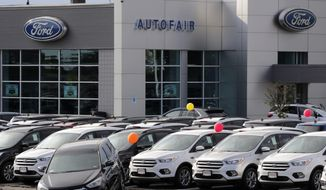FILE - In this Thursday, Aug. 15, 2019 file photo,Cars for sale at the Ford dealership in Manchester, N.H. New vehicle sales in the U.S. fell slightly last year, but the numbers still passed the healthy 17 million mark for the fifth straight year. Automakers sold 17.1 million new cars, trucks and SUVs in 2019, down about 1% from the previous year.  (AP Photo/Charles Krupa, File)