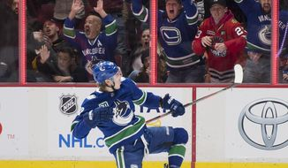Vancouver Canucks center Adam Gaudette celebrates his goal against the Chicago Blackhawks during the third period of an NHL hockey game Thursday, Jan. 2, 2020, in Vancouver, British Columbia. (Jonathan Hayward/The Canadian Press via AP)