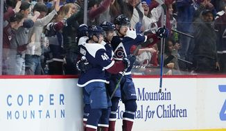 Colorado Avalanche center Pierre-Edouard Bellemare, center, celebrates a goal against the St. Louis Blues with teammates Samuel Girard (49) and Valeri Nichushkin during the second period of an NHL hockey game, Thursday, Jan. 2, 2020, in Denver (AP Photo/Jack Dempsey)