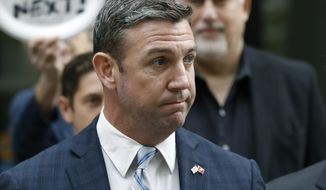 """FILE - In this Tuesday, Dec. 3, 2019, file photo, California Republican Rep. Duncan Hunter speaks after leaving federal court in San Diego. Hunter is staying mum on when he will resign following his guilty plea for siphoning campaign money for personal expenses, drawing the ire of a fellow Republican seeking to replace him. Hunter said last month that he would step down """"shortly after the holidays."""" (AP Photo/Gregory Bull, File)"""