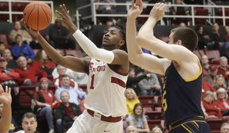 Stanford guard Daejon Davis (1) shoots next to California forward Grant Anticevich during the first half of an NCAA college basketball game in Stanford, Calif., Thursday, Jan. 2, 2020. (AP Photo/Jeff Chiu)