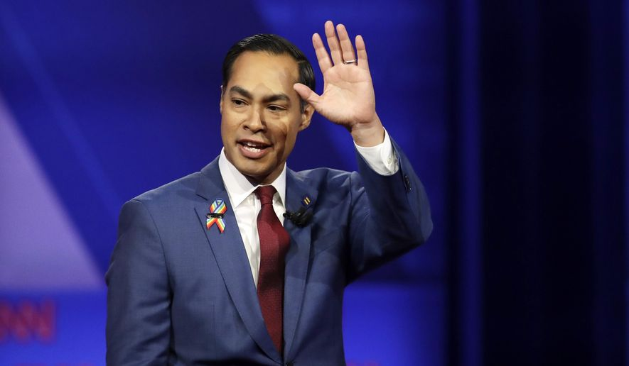 FILE - In this Oct. 10, 2019 file photo, former Housing and Urban Development Secretary and Democratic presidential candidate Julian Castro waves as he takes the stage during the Power of our Pride Town Hall in Los Angeles. (AP Photo/Marcio Jose Sanchez)