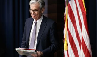FILE - In this Dec. 11, 2019, file photo Federal Reserve Chair Jerome Powell arrives to speak at a news conference after the Federal Open Market Committee meeting in Washington. On Thursday, Jan. 2, 2020, the Federal Reserve releases minutes from its December meeting when it kept its key interest rate unchanged. (AP Photo/Jacquelyn Martin, File)
