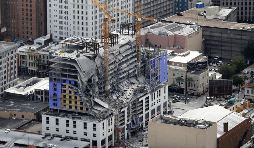 FILE - This Oct. 12, 2019, file photo, shows damage of a partial collapse at the Hard Rock Hotel under construction in New Orleans. New Orleans officials say the hotel that partially collapsed, killing three people, won't be totally demolished until the end of the year.  (AP Photo/Gerald Herbert, File)