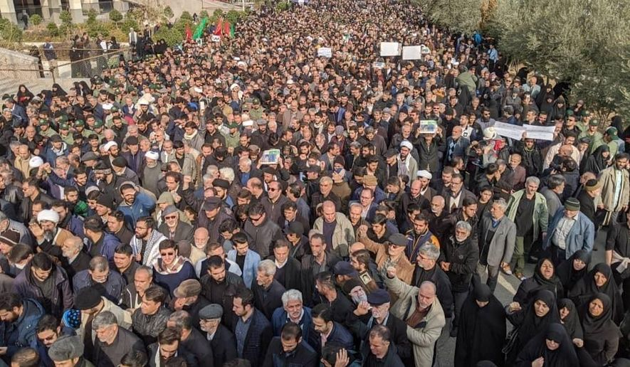 """Protesters demonstrate over the U.S. airstrike in Iraq that killed Iranian Revolutionary Guard Gen. Qassem Soleimani in Tehran, Iran, Jan. 3, 2020. Iran has vowed """"harsh retaliation"""" for the U.S. airstrike near Baghdad's airport that killed Tehran's top general and the architect of its interventions across the Middle East, as tensions soared in the wake of the targeted killing. (AP Photo/Vahid Salemi)"""