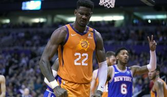 Phoenix Suns center Deandre Ayton (22) reacts after blocking a shot by New York Knicks forward Julius Randle in the first half during an NBA basketball game, Friday, Jan. 3, 2020, in Phoenix. (AP Photo/Rick Scuteri)